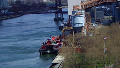 Grand Day: NYC by Car Over Roosevelt Island (catchesthelight) Tags: bridge building boat industrial manhattan bluesky views eastriver rooseveltisland newyorkcityny springvisit travelbycar april2016