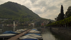 Lugano (Diego Innocenti) Tags: park mountain lake mountains alps nature water landscape boats switzerland landscapes boat reflex path swiss paths svizzera alp lugano hs20 hs20exr