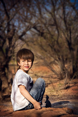 Snorri and the forest (Sigrun Saemundsdottir) Tags: trees boy playing nature boys water look childhood forest children toy outside toys outdoors kid sitting child looking dinosaur dirt playtime lookingback mesquitetrees childinnature sigrunsaemundsdottirphotography mesquiteforest