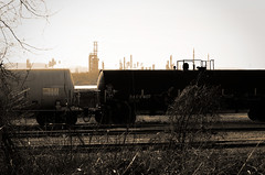 life blood (fallsroad) Tags: railroad blackandwhite bw industry train industrial oil duotone refinery arkansasriver tulsaoklahoma nikond7000
