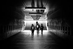Passing through... (ewitsoe) Tags: street school urban blackandwhite bw reflection monochrome kids stairs train 35mm underground nikon map room tram poland tourist journey backpacks passage poznan weneed d80 childrenteens citycityscape dailyjourney ewitsoe
