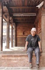 Nepali Fan of Guinness (David L. Merin) Tags: guinness shirt traditional carving nepal old kirtipur kathmandu valley brick wood tavel