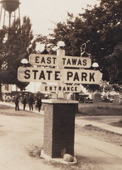 NE East Tawas MI RPPC Just East of Downtown Stores & Businesses this Great State Park Entrance View Tent Camps setup Playground to the right Lake Huron Tawas Bay straight ahead2 (UpNorth Memories - Donald (Don) Harrison) Tags: travel usa heritage history tourism st vintage antique michigan postcard memories restaurants hotels trailer roadside upnorth steamship cafes excursion attractions motels mackinac cottages cabins campgrounds city bridge island car upnorthmemories rppc wonders big railroad michigan memories mac state parks entertainment natural harrison roadside ferry travel don tourist mackinaw stops upnorth straits ignace
