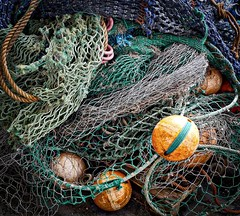 fishing nets and floats P1160503 (friendlydrag0n) Tags: ocean sea net industry fishing rope catch float vignette snare