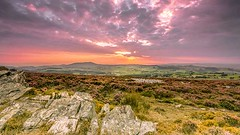Sunset from Stiperstones Ridge to Cordon Hill (Jim Key) Tags: pink sunset orange yellow wales clouds landscape rocks shropshire view purple stones heather hill deep ridge valley fields rays patchwork cordon stiperstones camlad