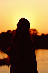 and everything in sight was lost in silhouette (shadman ali) Tags: sunset sky reflection girl silhouette canon eos 50mm warm dhaka bangladesh goldenhour sunflare shadman sunflares 700d canon700d t5i canont5i shadmanali shadmanaliphotography shadmanphotography