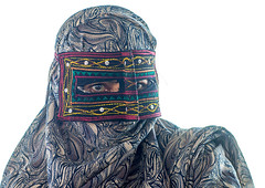 a bandari woman wearing the traditional mask called the burqa on a market, Hormozgan, Bandar Abbas, Iran (Eric Lafforgue) Tags: portrait people woman horizontal outdoors persian clothing asia veil mask iran market muslim islam religion hijab persia headshot hidden covered iranian bazaar adults adultsonly oneperson islamic burqa ethnicity middleeastern frontview persiangulf sunni bandarabbas burka chador balouch hormozgan onewomanonly lookingatcamera burqua   embroidering 1people  iro straitofhormuz  colourpicture  borqe boregheh iran034i1878