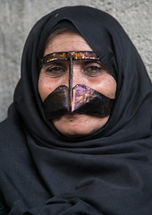 a bandari woman wearing a traditional mask called the burqa with a moustache shape, Qeshm Island, Salakh, Iran (Eric Lafforgue) Tags: portrait people woman face vertical outdoors persian clothing asia veil mask iran muslim islam religion hijab culture persia headshot hidden covered iranian adults adultsonly oneperson islamic traditionaldress burqa customs ethnicity middleeastern persiangulf sunni qeshmisland burka chador hormozgan onewomanonly burqua middleagedwoman   1people  iro straitofhormuz  colourpicture  salakh borqe boregheh irandsc03431