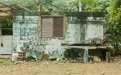 Crumbling (BradPerkins) Tags: wood building abandoned lines concrete paint dominicanrepublic urbanlandscape redwindow