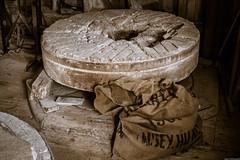 Lode Millstone (aljones27) Tags: mill stone sepia nt millstone sack nationaltrust lodemill angelseyabbey