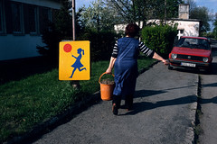 . (www.piotrowskipawel.pl) Tags: street red woman girl yellow work bucket village candid balloon streetphotography poland polska dia slidefilm roadsign decisivemoment polishvillage colorstreetphotography województwodolnośląskie dobroszyce pawełpiotrowski piotrowskipawelpl