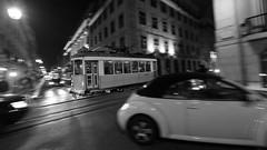 Crazy traffic!!! (marcolemos71) Tags: street city bw monochrome vw night canon lights blackwhite nightshot traffic lisbon streetphotography cablecar panning monocromtico tram28 pretobramco electrico28