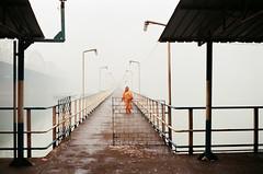 Walk (AnimeshHazra) Tags: street bridge orange woman india lines streetlight geometry walk kolkata bengal dakshineswar