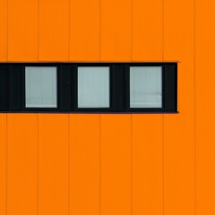 Three little birds sq orange (Andrea Kennard) Tags: windows light abstract colour lines metal architecture square industrial shadows balcony curves structure