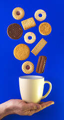 Floating Biscuits (darrenball189) Tags: blue food brown cup glass cookies yellow closeup golden nice nikon funny cookie hand candy tea sweet eating chocolate background wheat traditional cream floating tasty sandwich sugar delicious biscuit eat snack round mug biscuits custard treat crumbs diet jam bake fib crunchy isolated contour confectionery hover digestive nutrition calories d610