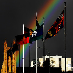 rainbow over Adelaide (mernamora) Tags: sky storm weather rainbow cityscape flags adelaide brooding