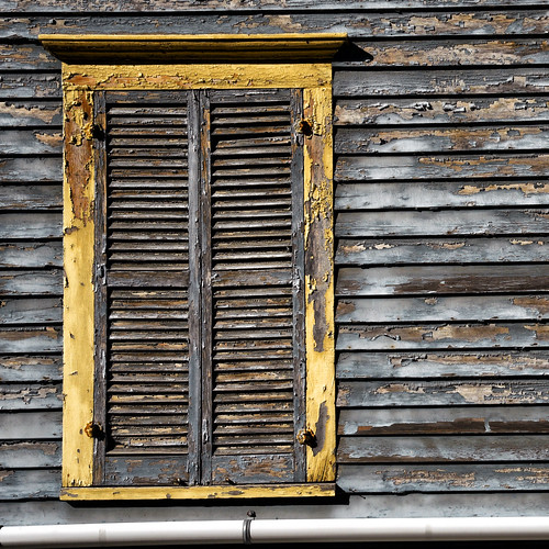 Yellow Window with Shutters