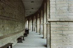 Mini Graffiti (Gravitational Lensing) Tags: italy film analog bench minolta kodak bricks tunnel arches analogue manualfocus srt101 srt gold200 cascatedellemarmore