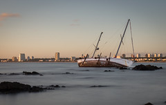 Floating in smoke (nicoschmalzl) Tags: travel beach water canon uruguay boat waterfront outdoor floating shipwreck puntadeleste longtimeexposure canon6d