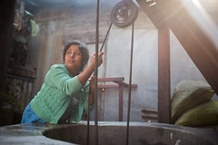A woman heaves water from a well in the early morning for laundry. Shan State, Myanmar. (Jeff Williams 03) Tags: light water earlymorning well myanmar shanstate