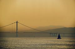 For sail (Melissa Maples) Tags: morning bridge sea orange mountains water silhouette sailboat sunrise turkey dawn boat nikon asia trkiye nikkor vr afs  marmara 18200mm  f3556g  18200mmf3556g eskihisar d5100