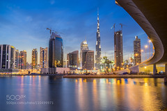 Downtown Dubai (Justin S Reid) Tags: city travel bridge light sunset sky urban reflection building tower water skyline architecture night skyscraper long exposure downtown dubai cityscape uae emirates khalifa burj 500px ifttt dierjscreensaver