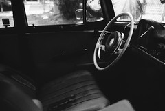 *** (Justin Wolfe) Tags: city winter shadow urban blackandwhite black classic film philadelphia window car analog 35mm canon vintage dark downtown noir kodak interior empty streetphotography minimal cadillac grill flashback chrome 35mmfilm hood philly analogue simple cinematic timeless urbanphotography urbex filmphotography canonf1