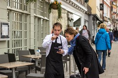 Waiting on directions (Silver Machine) Tags: street woman restaurant outdoor candid streetphotography streetportrait directions windsor pointing berkshire canoneos waiter marcopierrewhite canon600d canonef50mmf18stm