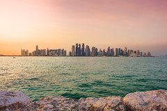 Doha skyline (Edison Evilla) Tags: sunset skyline landscape corniche doha qatar