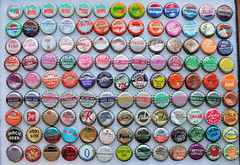 Pop Cap Donations (J-Fish) Tags: radio sunrise pop mountaindew collection drpepper pepsi soda cocacola dietpepsi crush moxie rootbeer tropicana aw 7up fanta bottlecaps cottonclub orangecrush canadadry rccola popshoppe temagami beercaps nehi birchbeer d300s 35mmf18g luckycola