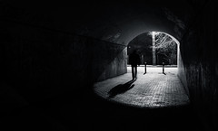 Out of the Dark | Day 179 / 365 (marcin baran) Tags: street light shadow urban bw white man black blur lamp monochrome mystery night dark out walking person evening blackwhite blurry long alone darkness pov walk empty poland polska tunnel stranger human mysterious lonely 365 passage element zabrze gliwice marcinbaran