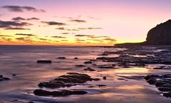 Tarde costera (Gaston Ferreyra) Tags: ocean light sunset patagonia sunlight luz argentina atardecer la mar rocks free el gratis condor boca libre tarde rocas oceano acantilados argen descargar