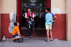 Simplicity is happiness (RM Ampongan) Tags: smile kids beda for living student gate san philippines happiness business colored exit selling minded mendiola