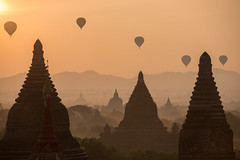 HPO_6156+G+500 (Sarawut intarob) Tags: sky mountain nature weather silhouette horizontal fog architecture outdoors photography pagoda flying buddhism nopeople transportation hotairballoon myanmar midair bagan traveldestinations colorimage modeoftransport templebuilding builtstructure sunrisedawn