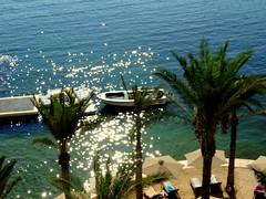 Moored (Khaled M. K. HEGAZY) Tags: blue sea white green beach nature water alexandria closeup boat seaside chair nikon mediterranean outdoor egypt parasol palmtree coolpix البحر بحر قارب p520 البحرالمتوسط