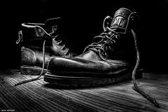 Worn out Boots (Jamal Benamer) Tags: shadow blackandwhite bw lightpainting art darkroom canon dark darkness boots 1855mm conceptual wornout darkart 450d wornoutshoes