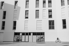 Lonely (Rebel Yell 82nd) Tags: street blackandwhite bw milan art bicycle architecture nikon italia child milano streetphotography sigma lombardia bicicletta 1835mm d7000