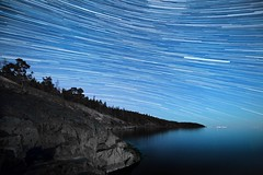 Moon Lightpaint & Startrails (Edgar Myller) Tags: longexposure light sea sky moon nature water rock stone night airplane landscape star paint air airplanes trail pollution startrails startrail lightpaint porkkala