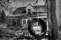 This used to be my Playground (sminky_pinky100 (In and Out)) Tags: old travel bw canada tree tourism home broken landscape outdoors wooden novascotia shadows decay branches tire rope tireswing abandonedhouse ruraldecay decaying fallingdown omot cans2s
