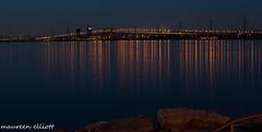 Pre-Dawn Lights (maureen.elliott) Tags: bridge water reflections dark lights colours predawn bluelight burlingtonskyway lkaeontario