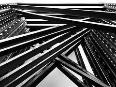 A Crush, A Hero-Worship & Hyperrealism (Isabelle de Touchet) Tags: blackandwhite lines blackwhite pattern geometry steel structure lookingup fujifilmfinepixjx500 isabelledetouchet