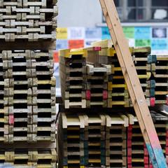 a ladder and wooden stacks (zeh.hah.es.) Tags: wood blue red rot yellow schweiz switzerland site construction zurich stack baustelle gelb ladder zrich blau holz leiter kreis5 hardbrcke stapel