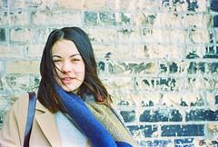 Keisha (e.m.alder) Tags: winter portrait woman brick film female analog 35mm model nikon kodak grain 135 nikkor nikonf c41 portra400 ftn photomic nikkors50mmf14 homedevelopment 50mmf14s canoscan9000f