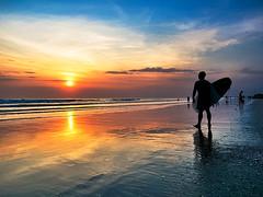 Pantai Kuta (Bulindo) Tags: travel sunset sea beach water sport clouds coast sand surf surfer sunsets beachlife shore surfboard tropical moment beatiful pantai kutabeach yolo pantaikuta surflife indosurf