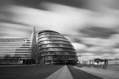 City Hall (erikinlondon) Tags: city longexposure bridge urban blackandwhite london monochrome architecture clouds moody cityhall fineart bnw darksky thethames