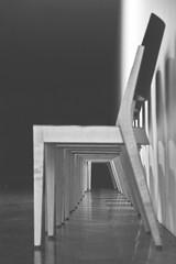 Chair Row (C_MC_FL) Tags: blackandwhite bw canon eos blackwhite chair focus fotografie dof pov empty leer raum room tunnel row depthoffield pointofview repetition sw pho tamron sessel schrfentiefe repeating fokus reihe blickwinkel tiefenschrfe schwarzweis 18270 60d b008 hintereinander