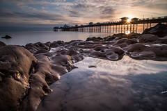 Sunrise at the Pier (A Crowe Photography) Tags: morning reflection wales sunrise canon pier cymru llandudno northwales llandudnopier welshlandscape venuecymru welshflickrcymru northeastwales welshphotographer welshphotography cloudsstormssunsetssunrises