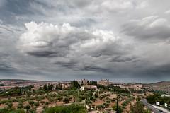 BAJO LA NUBE (mamherrera) Tags: old city espaa clouds capital catedral ciudad paisaje toledo cielo alcazar montaa nube panormica castillalamancha airelibre patrimoniodelahumanidad