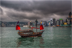 Hong Kong junk boat (Chas56) Tags: city red sea urban storm water skyline clouds canon buildings boats hongkong lights evening harbor boat twilight cityscape waterfront cloudy harbour wide sails wideangle stormy cityskyline hongkongharbour 1635mm canon5dmkiii