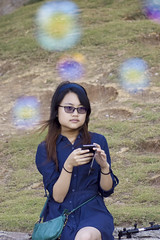 Claire (bdrc) Tags: portrait beach girl lens seaside minolta zoom candid sony wave bubbles shore tele casual 75300mm teluk chempedak f4556 a6000 asdgraphy